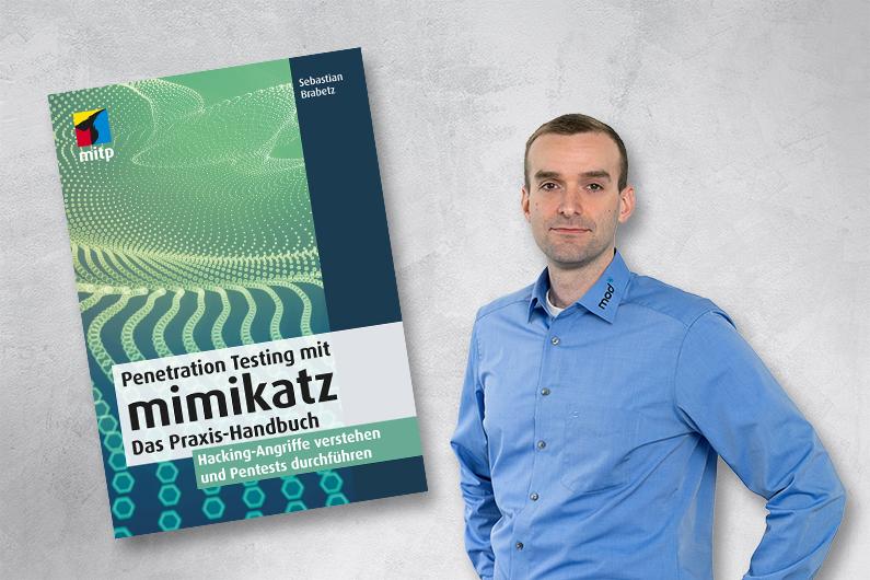 Sebastian Brabetz von mod IT mit seinem neuen Buch über Pentesting mit Mimikatz